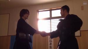 The man-to-man buddy handshake (good lighting by the way)