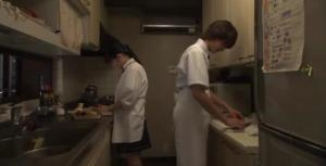 Asuka helping Ryo out in the kitchen for her father's birthday