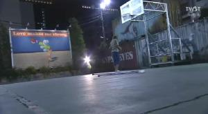 As Naoki tries to shoot a hoop with his injured leg at the usual basketball court where they hang out, the ball bounces off the board without going into the hoop. Naoki hobbles over to catch the rebound and stands morosely beneath the board